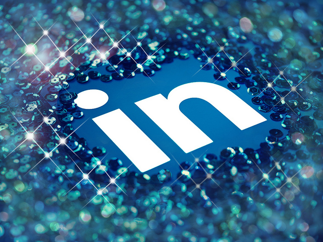 The LinkedIn logo presented in the middle of the image surrounded by sparkling sequins