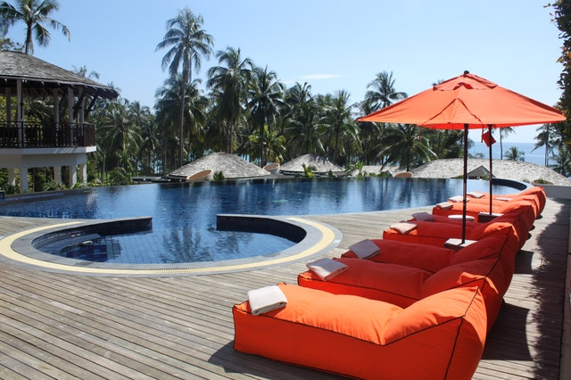 Orange loungers beside swimming pool