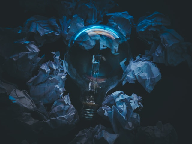 Close up of a bulb surrounded by crumpled paper