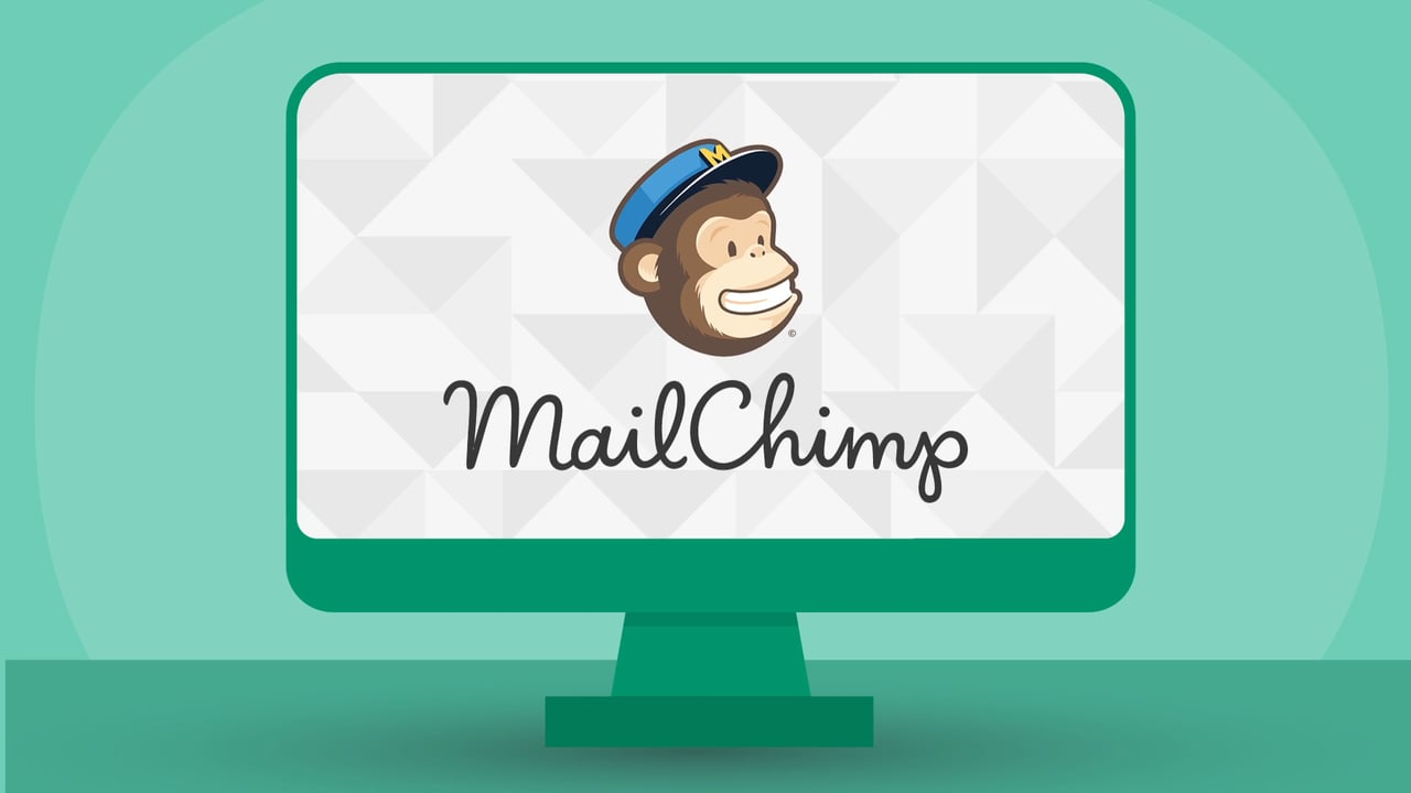 The MailChimp logo which is a monkey with a blue hat on and the words MailChimp written below placed inside a green box
